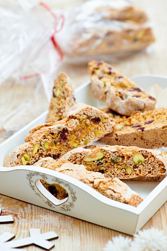 Biscotti with pistachios on a wooden tray