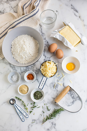 Various baking ingredients on a marble surface