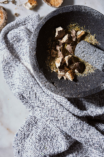 Raw mushroom tea in a mortar