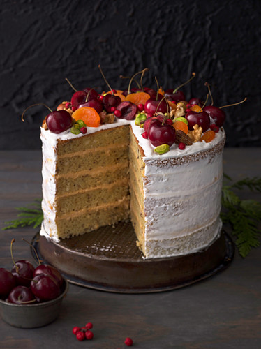A festive layer cake with a cream filling, sliced