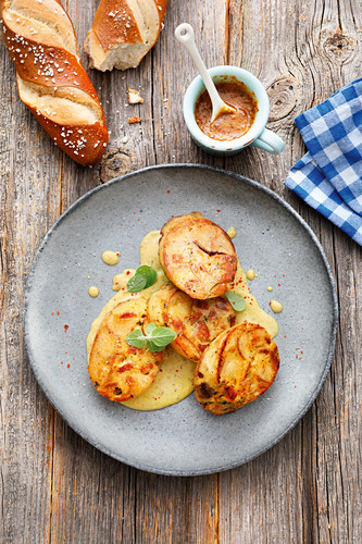 Pretzel and white sausage dumplings with mustard sauce