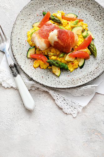 Saffron risotto with monkfish in parma ham