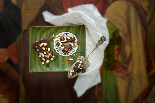 Panforte with almonds and Amarena cherries on a painting