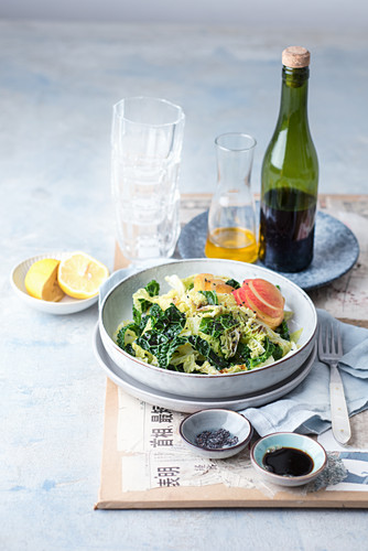 Savoy cabbage salad with apples, black sesames seeds and a lemon and soya dressing (Asia)