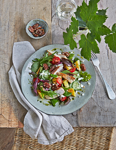A colourful summer salad with grilled pineapple, chicken breast and feta cheese