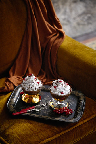 Chocolate pudding with cream and redcurrants