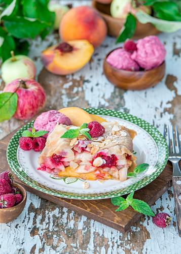 Apple, peach and raspberry strudel