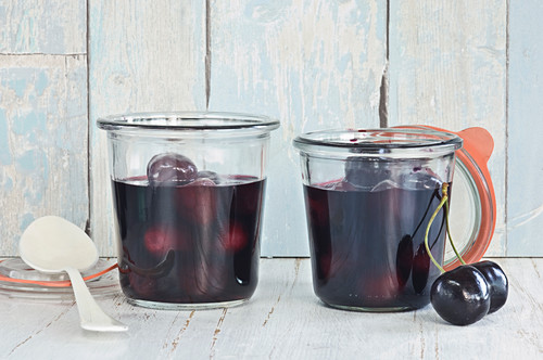 Cherry compote in preserving jars