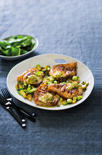 Pork chops with chimichurri butter and brussel sprouts