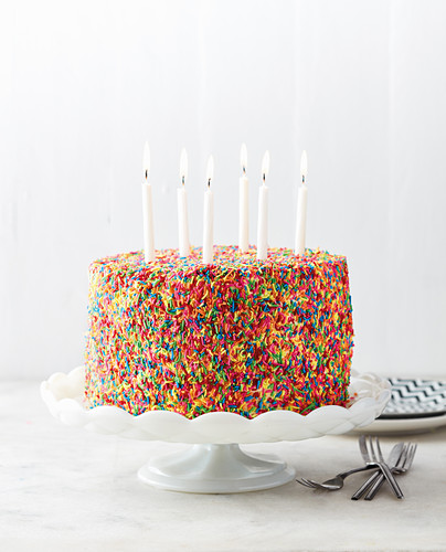 Funfetti cake: birthday cake with colorful sugar sprinkles and candles