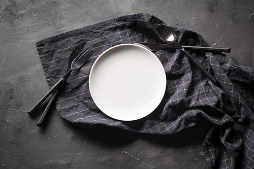 Empty dish seen from above with cutlery