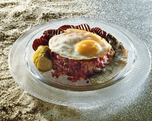 Labskaus (fish & potato dish), fried egg, beetroot & gherkins