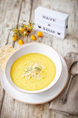 Yellow tomato soup with pecorino cheese