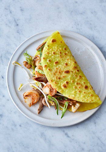Vietnamese stuffed rice flour and coconut crepes with prawns