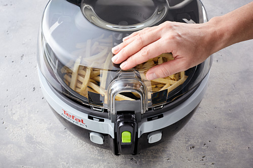 A hot-air fryer being closed