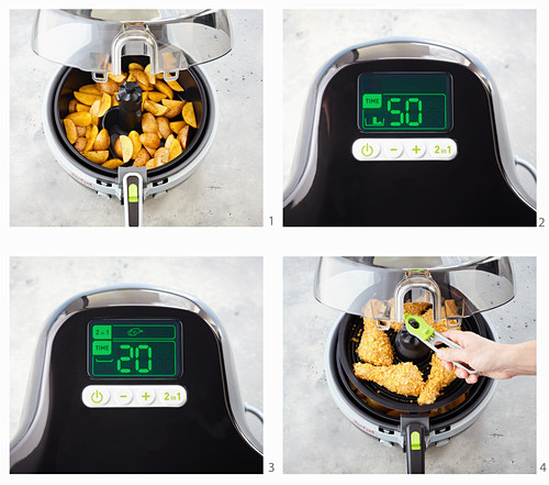 Chicken and potato wedges being made in a hot-air fryer