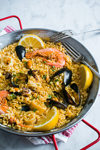 Paella with sea food and mayer lemons