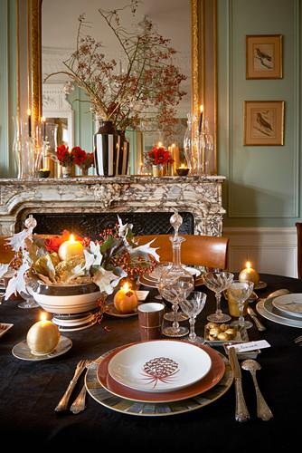 Festively set table next to fireplace