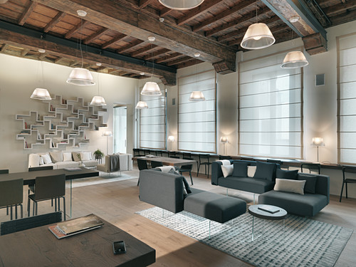 A large room with a rustic wood-beam ceiling and elegant grey and white furniture