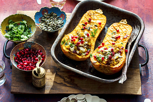 Middle eastern roasted butternut squash with quinoa and pomegranate
