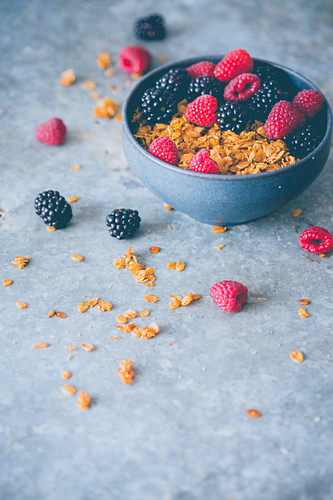 Bowl of homemade granola with fruits