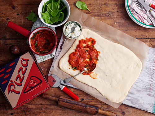 Pizza dough with tomato sauce