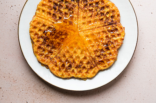 Sweet potato and cinnamon waffles with maple syrup