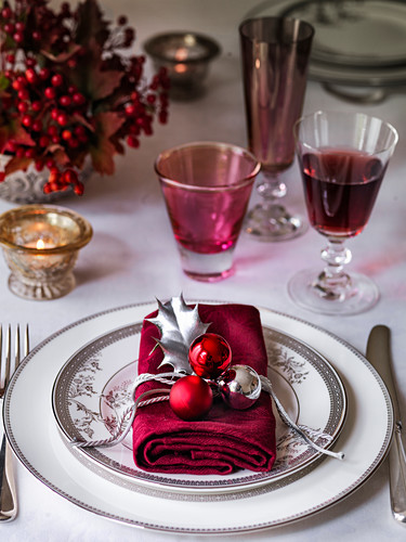 Christmas table setting with napkin and wine glasses