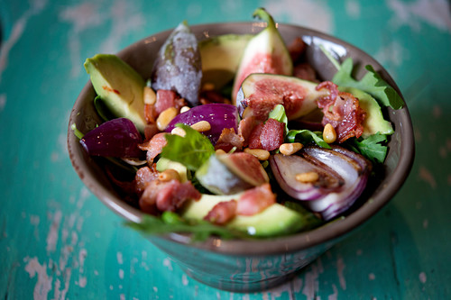 Fig salad with bacon, avocado, red onions and pine nuts