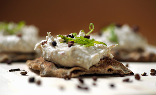 Crispbread with crab cream and Sichuan pepper (close-up)