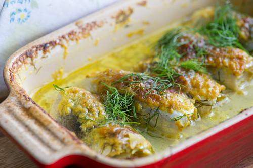 Gratinated Baltic herring with curry, dill and lemon