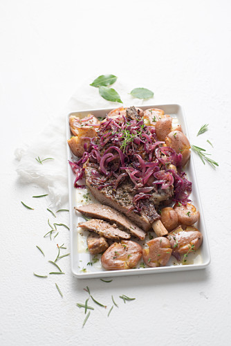 Roast veal with caramelised onions and potatoes