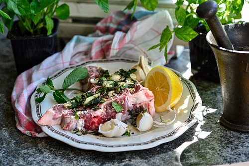 Marinated lamb chops with mint, lemon zest, garlic, salt, pepper and olive oil
