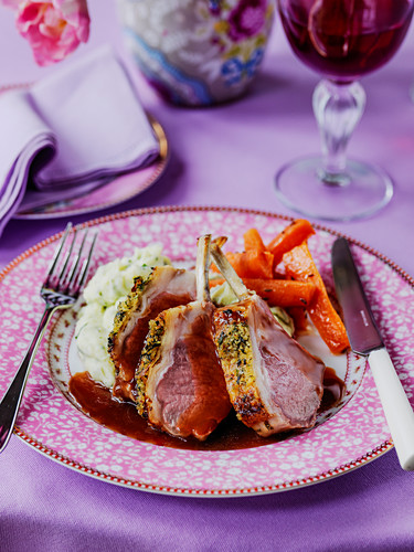 Easter rack of lamb with pistachio herb crust glazed carrots and mashed potato with red wine gravy
