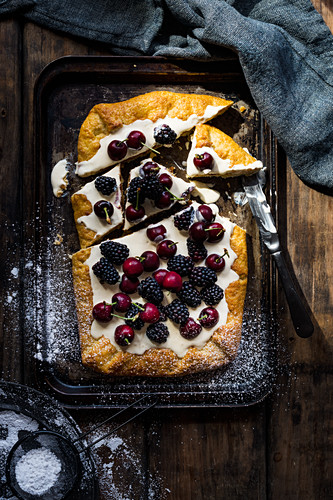 White Chocolate Tart with cherries and blackberries