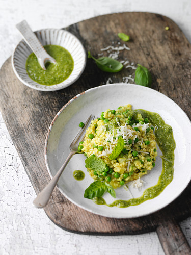 Barley risotto with pesto, peas and turmeric