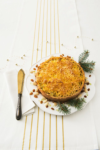 Christmas cake with a golden angel's hair crust