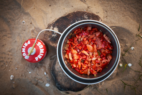 Tomato sauce in a pot being cooked on a gas burner
