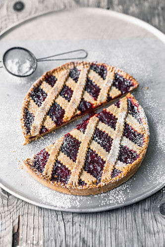 A small Linzer tart with currant jam