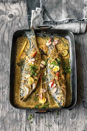 Whole sea bass in Thai curry broth