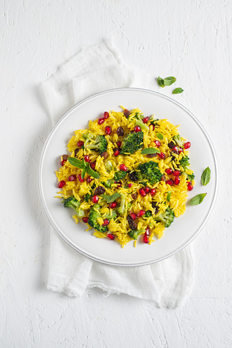 Fried saffron rice with broccoli, peppermint and pomegranate