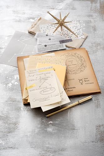 Still-life arrangement of astrology book and handwritten notes