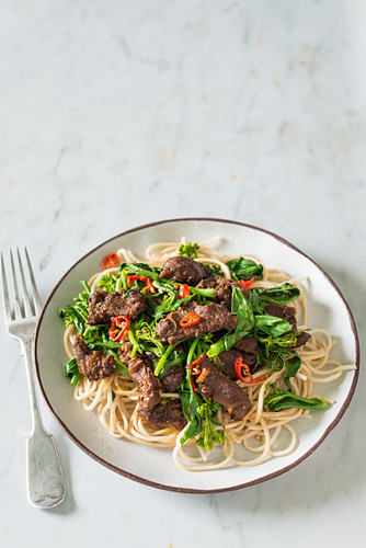 Noodles with sauted beef and broccoli sprouts