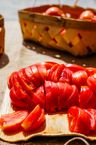 Sliced juicy red tomatoes in afternoon sunlight