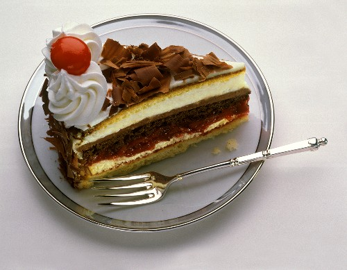 A piece of Black Forest cherry gateau on cake plate