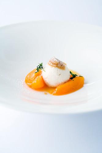 Potato dumplings on apricot compote