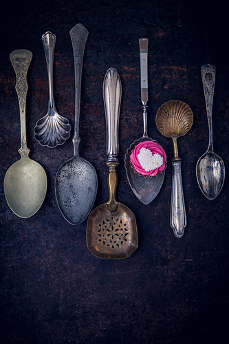 Vintage spoons, one with chocolate candy