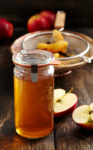Homemade baked apple liqueur with vanilla, anise, cinnamon and corn schnapps