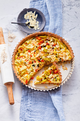 Vegetable tart topped with almonds