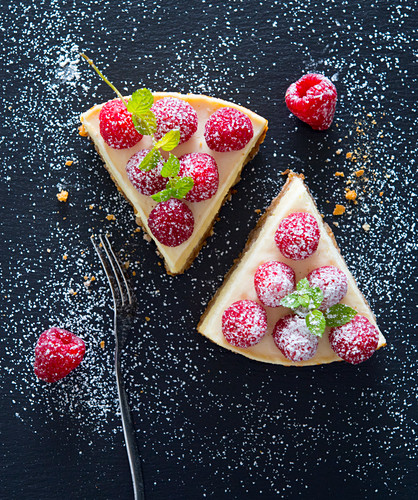 Two slices of raspberry cheesecake
